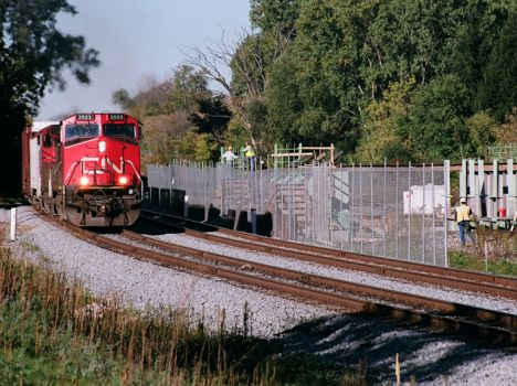 CN 2523 heads eastbound with a mixed freight at Farm Lane (construction) at East Lansing - 2008 [Douglas Thayer photo]